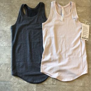 two lululemon aerial silk tanks.